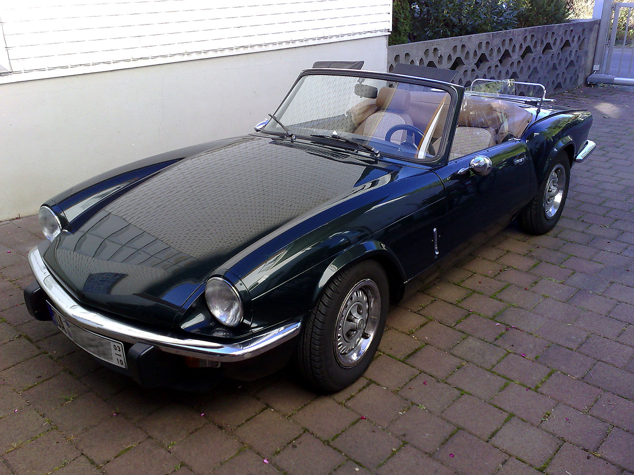 Triumph Spitfire on purple convertible car seat